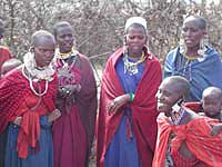 Greeting Maasai Women on Serengeti by G. Guller