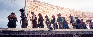 Women working on roof of Potala - Lhasa